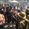 В здании КМДА забаррикадировались вооруженные автоматами люди в камуфляже