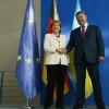Путин, Меркель и Порошенко неформально пообщались в Нормандии